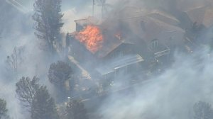 A home burns in Anaheim Hills on Oct. 9, 2017. (Credit: KTLA)