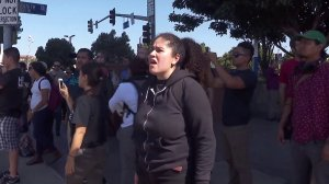 """Supporters chant """"let them go"""" after several demonstrators were detained in Westwood for blocking traffic on Oct. 5, 2017. (Credit: KTLA)"""