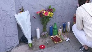 A small memorial is seen outside the store where Danny Bunthung was fatally shot. (Credit: KTLA)