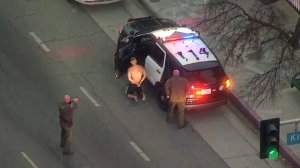 A man is taken into custody after a pursuit in a stolen Sheriff's Department vehicle on Oct. 31, 2017. (Credit: KTLA)