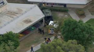 A person was placed into an ambulance after an hourslong hostage situation at a school in Riverside on Oct. 31, 2017. (Credit: KTLA)
