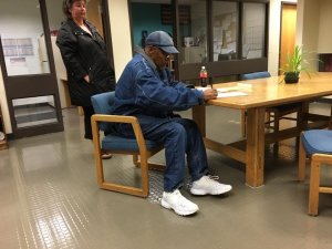 O.J. Simpson signs paperwork before his release from prison on Sunday, October 1, 2017. (Credit: CNN)