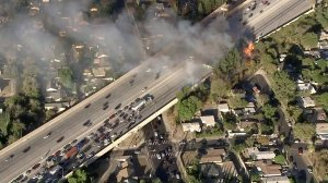 Traffic was backed up on the 118 Freeway in Granada Hills as firefighters tried to put out a blaze on Oct. 24, 2017. (Credit: KTLA)