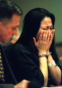 "Jeen ""Gina"" Han, sentenced to 26 years to life in prison in May 1998 for conspiring to kill her sister, is shown in 1997 with her attorney. (Credit: Ygnacio Nanetti/ Orange County Register / SCNG)"