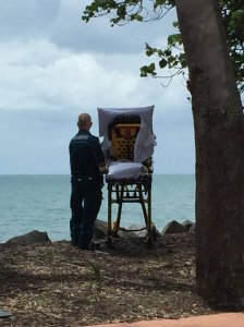 A dying woman is wheeled out to the ocean in a photo uploaded by the Queensland Ambulance Service to Facebook on Nov. 23, 2017.