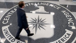 A man crosses the Central Intelligence Agency (CIA) seal in the lobby of CIA Headquarters in Langley, Virginia, on Aug. 14, 2008. 9çredit: Saul Loeb/AFP/Getty Images)