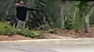 A man in a black shirt is seen aiming a bow and arrow in surveillance footage taken on Sept. 14, 2017. (Credit: Robyn and Chuck Tapert)