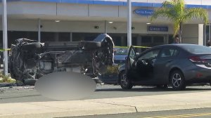 One person died after an SUV rolled over and ejected a passenger in Torrance on Nov. 14, 2017. (Credit: KTLA)