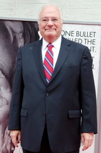 Joe Ricketts poses for photos on the red carpet during a movie premiere at Ford's Theatre on April 10, 2011, in Washington, D.C. (Credit: Kris Connor/Getty Images for Roadside Attractions)