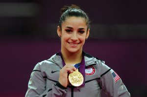 Gold medalist Alexandra Raisman poses on the podium on Day 11 of the London 2012 Olympic Games. (Credit: Michael Regan/Getty Images)