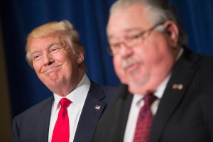 Republican presidential candidate Donald Trump listens as Sam Clovis speaks at a press conference on Aug. 25, 2015, in Dubuque, Iowa. (Credit: Scott Olson / Getty Images)