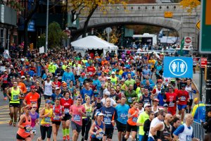 Runners make the turn onto First Avenue after crossing the Queensboro Bridge during the 2016 TCS New York City Marathon, November 6, 2016 in New York City. (Credit: Drew Angerer/Getty Images)