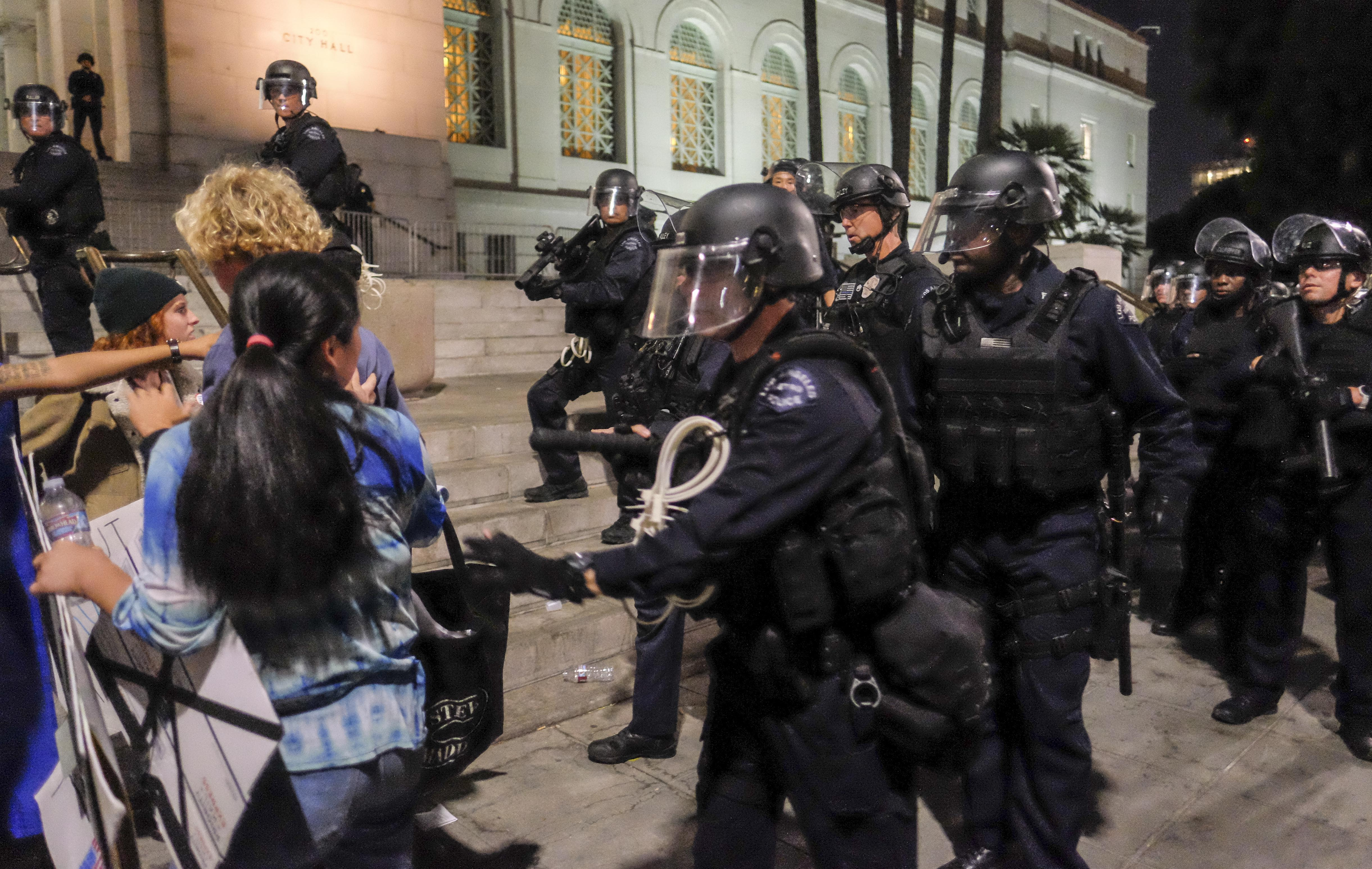 Police in riot gear confront demonstrators outside City Hall during a protest against President-elect Donald Trump in Los Angeles on Nov. 13, 2016. (Credit: RINGO CHIU/AFP/Getty Images)