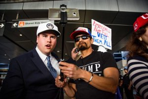 Trump supporters Omar Navarro (left) and Harim Uzziel live stream their counter-protest of the executive order by Donald Trump, banning immigrants from seven majority-Muslim countries at Los Angeles International Airport on February 4, 2017. (Credit: Kyle Grillot/AFP/Getty Images)