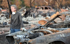Car collector Gary Dower speaks with neighbors at his fire-destroyed home in Santa Rosa, California on Oct. 20, 2017. (Credit: Josh Edelson / AFP / Getty Images)