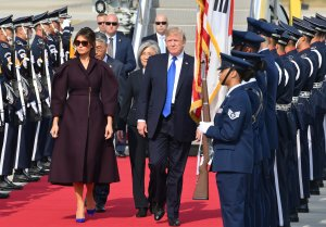 President Donald Trump and first lady Melania Trump arrive at the Osan Air Base in Pyeongtaek, south of Seoul on November 7, 2017. (Credit: SONG KYUNG-SEOK/AFP/Getty Images)