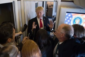 U.S. President Donald Trump speaks to the media onboard Air Force One after departing from Danang on his way to Hanoi, Nov. 11, 2017. (Credit: Jim Watson / AFP / Getty Images)