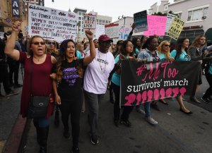 Victims of sexual harassment, sexual assault, sexual abuse and their supporters protest during a #MeToo march in Hollywood on Nov. 12, 2017. (Credit: Mark Ralston / AFP / Getty Images)