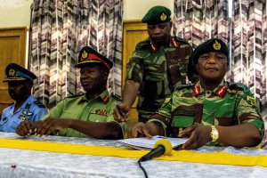 Zimbabwe Army General Constantino Chiwenga Commander of the Zimbabwe Defence Forces, right, and Valerio Sibanda Commander of the Zimbabwe National Army, second from left, address a media conference held at the Zimbabwean Army headquarters in Harare on Nov. 13, 2017. (Credit: Jekesai Njikizana / AFP / Getty Images)