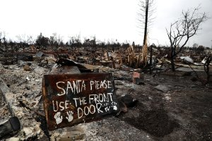 A sign is posted in front of a burned home in the Coffey Park neighborhood of Santa Rosa on Nov. 13, 2017. (Credit: Justin Sullivan / Getty Images)