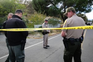 Law enforcement officers stand near one of many crime scenes after a shooting on Nov. 14, 2017, in Rancho Tehama, California. (Credit: Elijah Nouvelage / AFP / Getty Images)