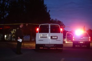 A Tehama County coroner's van enters the Rancho Tehama Elementary school grounds after a shooting on November 14, 2017, in Rancho Tehama. (Credit: ELIJAH NOUVELAGE/AFP/Getty Images)
