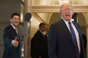 U.S. President Donald Trump leaves alongside Speaker of the House Paul Ryan after meeting with the House Republicans about tax reform at the Capitol, Nov. 16, 2017. (Credit: SAUL LOEB / AFP / Getty Images)