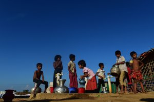 Rohingya refugee children collect drinking water from a tube well at Hakimpara refugee camp in the Bangladeshi district of Ukhia on Nov. 18, 2017. (Credit: Munir Uz Zaman / AFP / Getty Images)