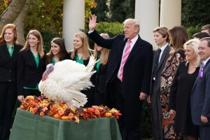 U.S. President Donald Trump, first lady Melania Trump, their son Barron, National Turkey Federation Chairman Carl Wittenburg and his family and members of the Draper County, Minnesota, 4-H chapter pose for photographs after Trump pardoned, Drumstick, the National Thanksgiving Turkey in the Rose Garden at the White House November 21, 2017 in Washington, DC. (Credit: Chip Somodevilla/Getty Images)