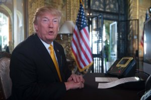 Donald Trump prepares his traditional address to thank members of the U.S. military via video teleconference from his residence in Mar-a-Lago in Florida on Thanksgiving Day, November 23, 2017. (Credit: Nicholas Kamm/AFP/Getty Images)