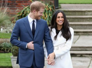 Prince Harry and Meghan Markle pose for photos to announce their engagement at Kensington Palace in London on Nov. 27, 2017. (Credit: Chris Jackson / Getty Images)