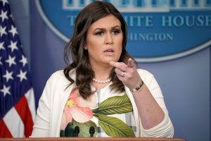 White House Press Secretary Sarah Huckabee Sanders talks with reporters during the daily news conference in the Brady Press Briefing Room at the White House November 27, 2017 in Washington, DC. (Credit: Chip Somodevilla/Getty Images)