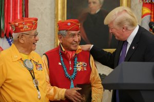 President Donald Trump greets members of the Native American code talkers during an event in the Oval Office of the White House, on Nov. 27, 2017. (Credit: Oliver Contreras -pool/Getty Images)