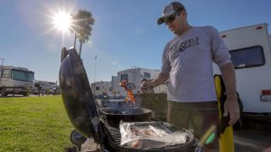 Steve Robinson, who came with his family from Bakersfield to camp at Dockweiler RV Park, prepares breakfast. (Credit: Irfan Khan / Los Angeles Times)
