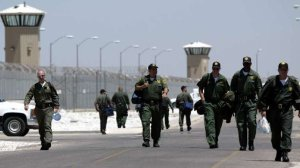 Guards arrive for their shifts at the California State Prison in Lancaster in 2004. (Credit: Bryan Chan/Los Angeles Times)