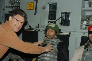 A photo shared by Leeann Tweeden on KABC.com shows Al Franken groping her breasts as she slept at an Army base in Iraq in 2006.