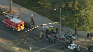 A man is being treated after an officer-involved shooting in Van Nuys on Nov. 15, 2017. (Credit: KTLA)