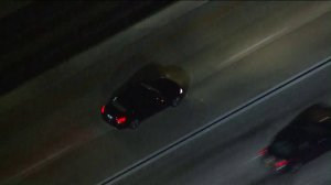 A vehicle is pursued by CHP officers on the 10 Freeway near Rosemead on Nov. 1, 2017. (Credit: KTLA)