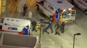 Luvelle Kennon is seen being transported on a stretcher after being shot by police following a standoff at a Riverside elementary school on Oct. 31, 2017. (Credit: Sky5 / KTLA)