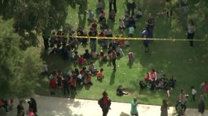 Students at Castleview Elementary School are evacuated after one of their teachers was taken hostage in a classroom on Oct. 31, 2017. (Credit: Sky5 / KTLA)