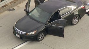 Bullet holes are seen in a car on the 210 Freeway in Fontana on Nov. 16, 2017. (Credit: KTLA)