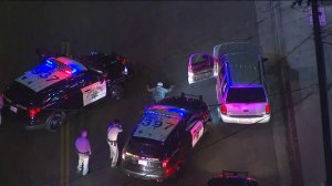 A pursuit suspect surrendered to authorities and was taken into custody in the Mid-City area on Nov. 2, 2017. (Credit: KTLA)