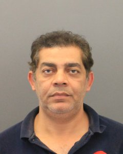 Adel Rezkallaa, 46, is seen in a booking photo released by the Orange County District Attorney's Office on Dec. 19, 2017.