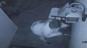 Surveillance footage from a camera at a home in Rancho Cucamonga shows an arsonist pouring fuel in an effort to light the home on fire on Dec. 14, 2017. (Credit: Rancho Cucamonga Police Department)