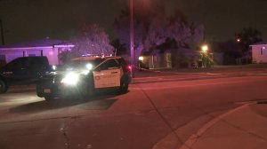 Authorities investigate a deputy-involved shooting in Artesia on Dec. 10, 2017. (Credit: KTLA)