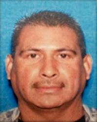 Pablo Cesar Cartagena is seen in a driver's license photo released Dec. 1, 2017, by the Los Angeles Police Department.