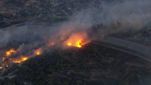 Smoke and flames rise from the Creek Fire near the Hansen Dam on Dec. 5, 2017. (Credit: KTLA)