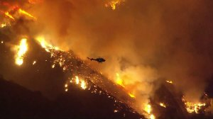 A wind-driven brush fire was burning out-of-control in the Santa Paula area on Dec. 4, 2017. (Credit: KTLA)