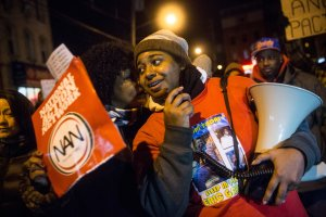 Erica Garner leads a march of people on Dec. 11, 2014 protesting a grand jury's decision not to indict a police officer involved in the chokehold death of her father, Eric Garner, in New York City. (Credit: Andrew Burton/Getty Images)