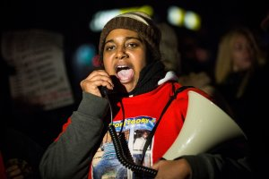 Erica Garner, daughter of Eric Garner, leads a march of people protesting the Staten Island, New York grand jury's decision not to indict a police officer involved in the chokehold death of Eric Garner in July, on December 11, 2014. (Credit: Andrew Burton/Getty Images)